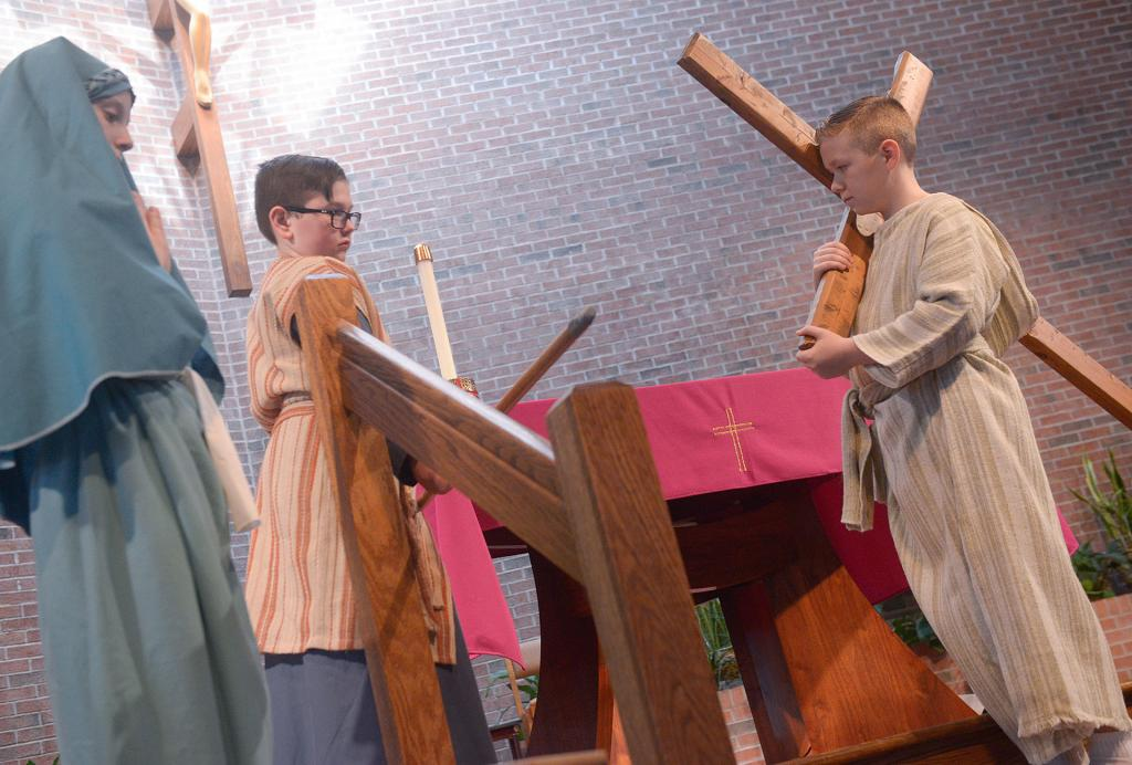 Sean Masiuk portrays Jesus as he and other fifth-grade students at Greece's St. Lawrence School enact the Living Stations of the Cross March 29 at St. Lawrence Church.