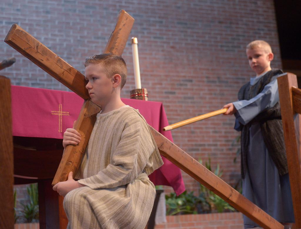 Jesus, portrayed by Sean Masiuk, falls for first time  as he carries the cross.
