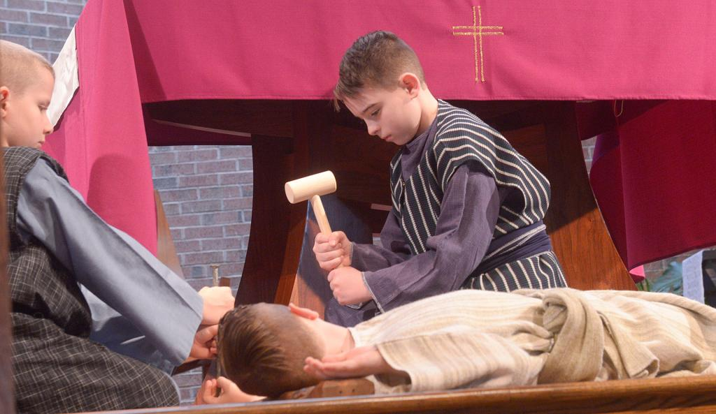 Sean Masiuk as Jesus is nailed to the cross by his fifth-grade classmates.