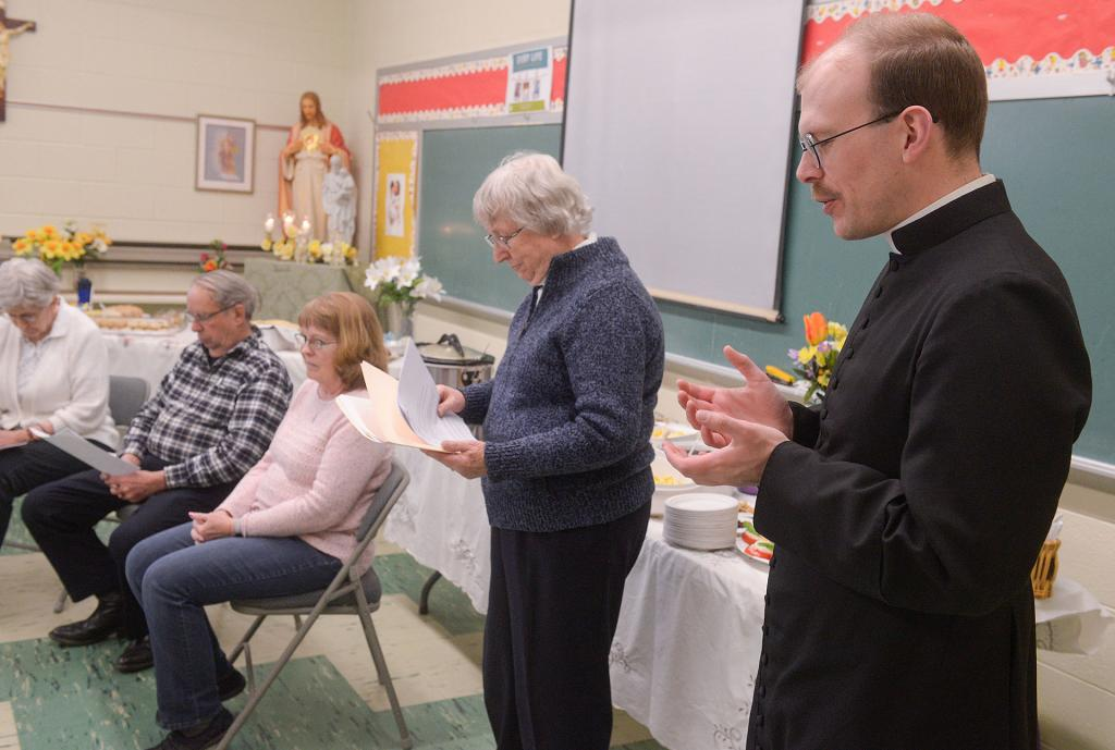 Father Peter Mottola gives a blessing during the celebration. (Courier photo by John Haeger)