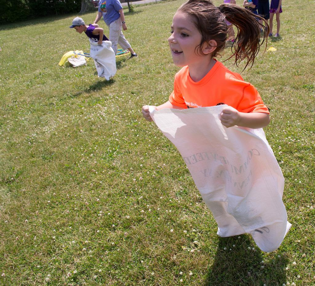 Nora Murphy, 6, competes in a relay race during Field Days at St. Michael School in Penn Yan.