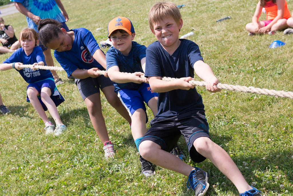 Kaleb Bryan, 10, works takes part in a tug-of-war contest during Field Days at St. Michael School in Penn Yan.