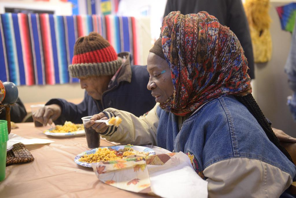 People eat during the Thanksgiving dinner Nov. 14 at the Father Tracy Health & Wellness Center.(Courier Photo by John Haeger)