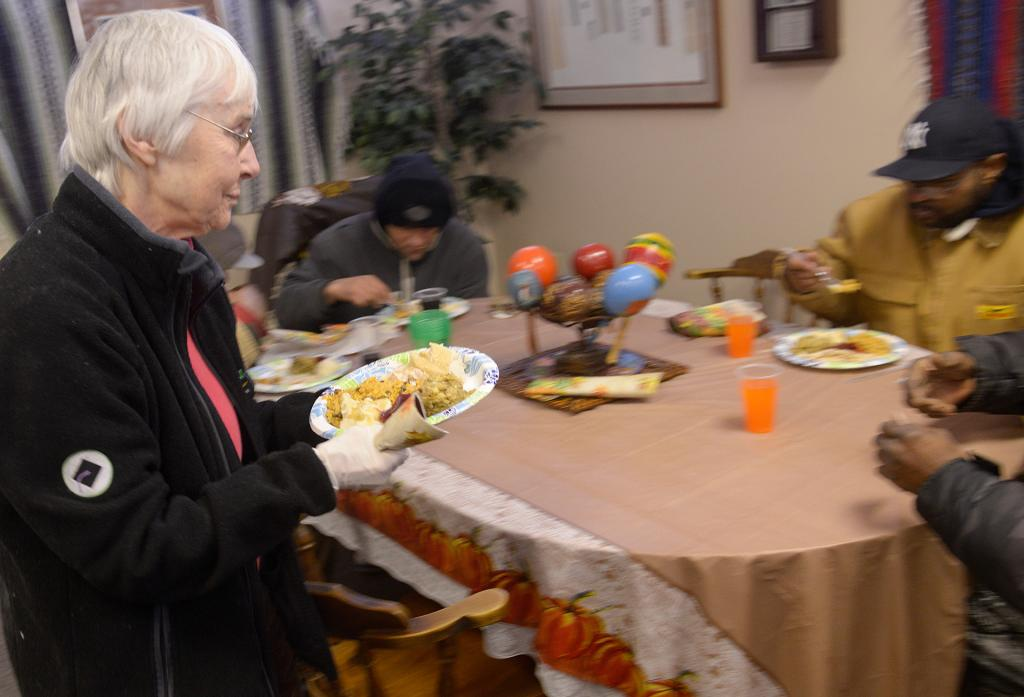 Sister Barbara Lum serves meals during the Thanksgiving dinner Nov. 14 at the Father Tracy Health & Wellness Center.(Courier Photo by John Haeger)