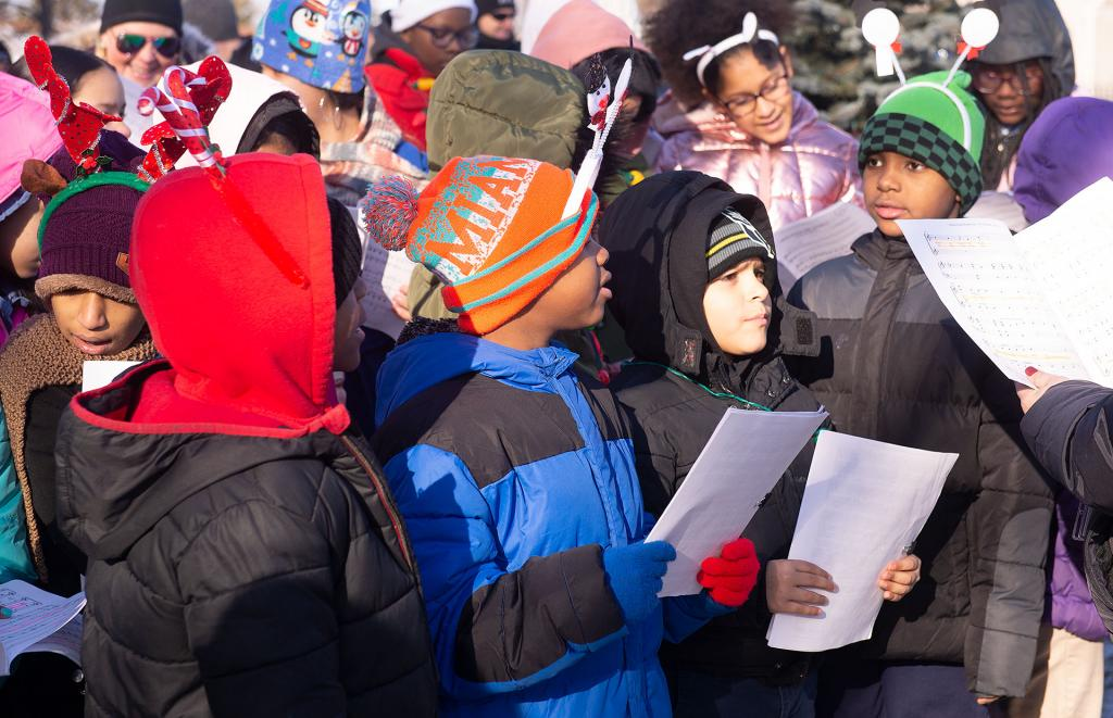 Students from Rochester's School No. 9 sing a Christmas carol during the tree lighting.