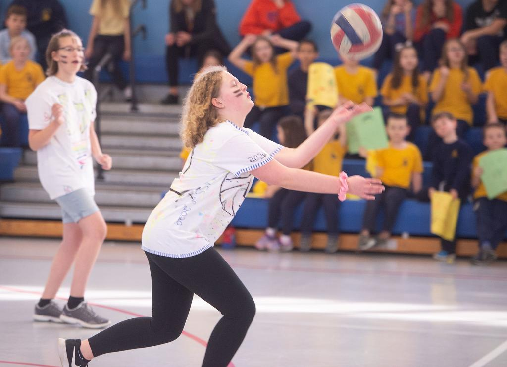 Molly Williams, an eighth-grader at St. Mary School in Canandaigua, reaches to return the shot during the annual seventh-grade/eighth-grade volleyball match Jan. 30 at the school. (Courier photo by John Haeger)