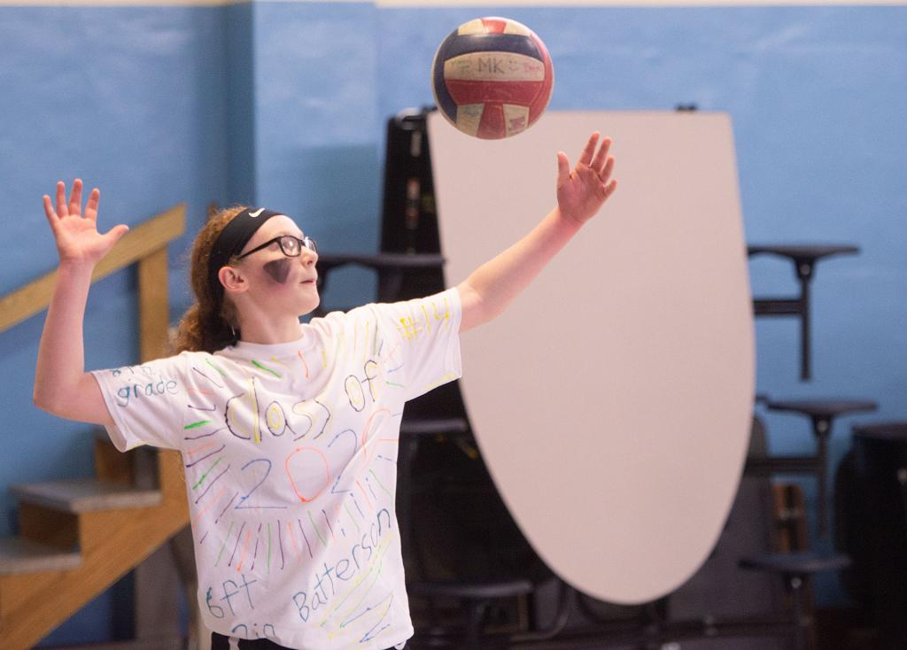 St. Mary School eighth-grader Leah Batterson serves the ball during the match. (Courier photo by John Haeger)