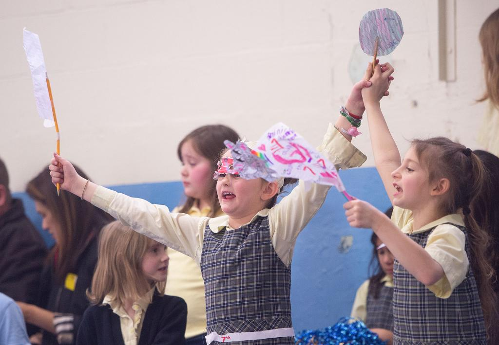 Underclassmen at St. Mary School cheer during the volleyball game. (Courier photo by John Haeger)