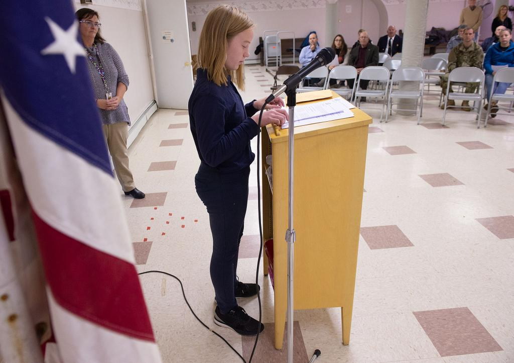St. Michael School fifth-grader Hayleigh Gilmartin reads a poem during the ceremony.