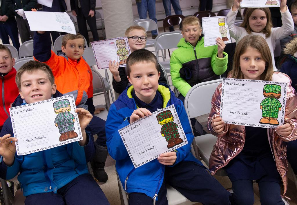 St. Michael School students pose with the cards to be given to veterans.