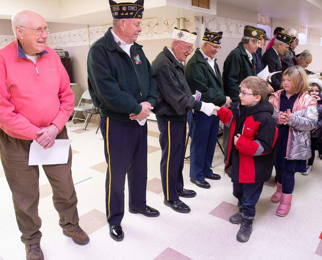 St. Michael School students present veterans with the cards they made and the letters they wrote.