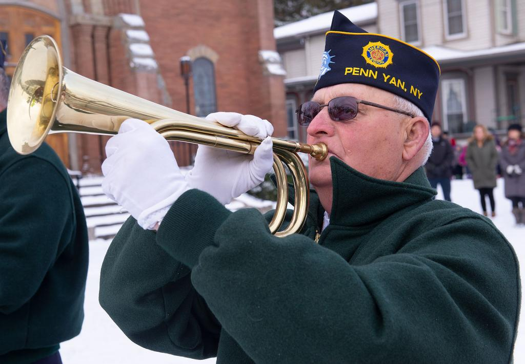 "Roger Sands plays ""Taps"" during the ceremony."