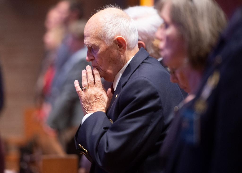 Dick Hillard, a member of the Knights of Columbus, prays during the Mass.