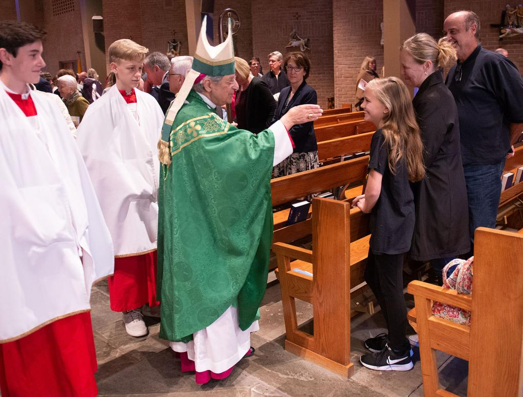 Bishop Matano blesses Isabella Foggetti and her mother, Paulette, at the end of the Mass.