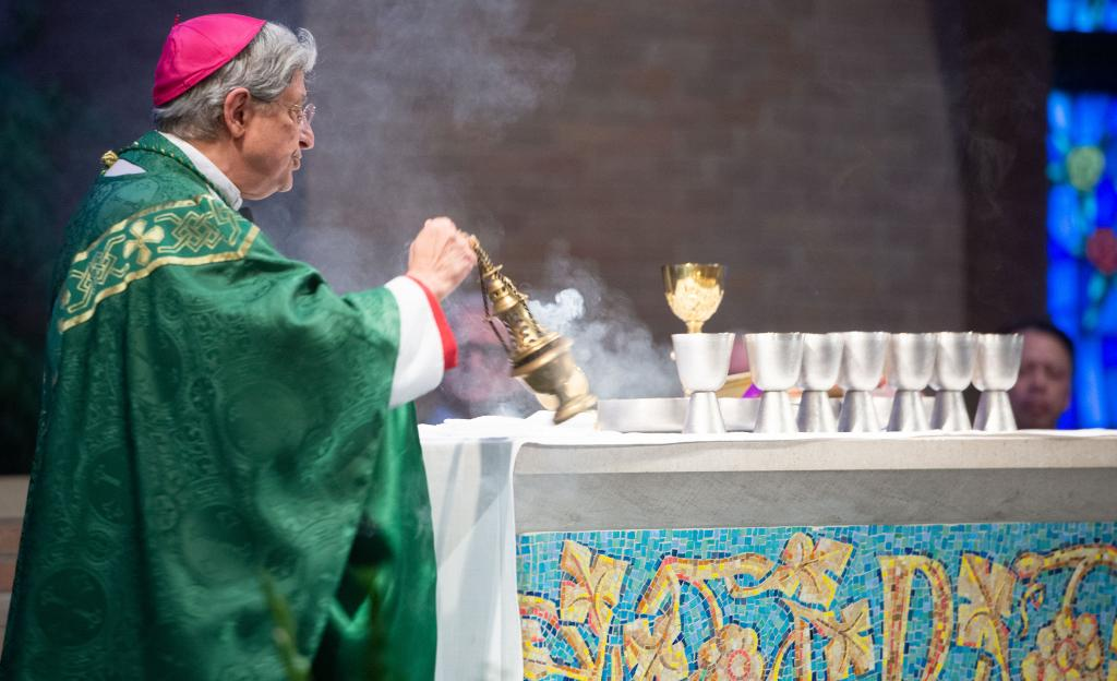 Bishop Matano censes the altar.