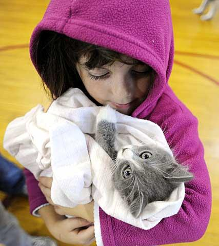 Lily Ruter holds her kitten, Mystic.