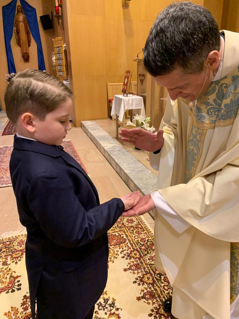 Patrick (left) with Father John Loncle, Pastor at Southeast Rochester Catholic Community. Patrick received his First Holy Communion at St. Boniface Church. (Submitted by grandmother, Dawn)