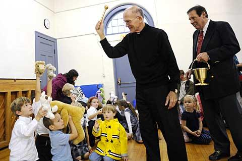 Father Richard Beligotti blesses stuffed animals.