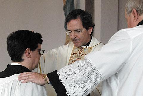 The Rev. Scott Hurd, vicar general for the Personal Ordinariate of the Chair of St. Peter, confirms Andrew Jordan Oct. 21 into the Fellowship of St. Alban, a group of former and present Anglicans seeking reception into the Catholic Church.