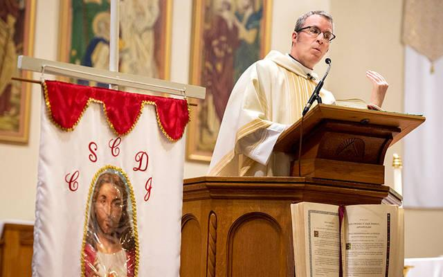 <p>Father William &ldquo;Mickey&rdquo; McGrath gives the homily during the 2017 feast day Mass for St. John the Baptist at Rochester&rsquo;s Holy Apostles Church. Father McGrath recently recalled the influences that shaped his vocational life. (Courier file photo)  </p>