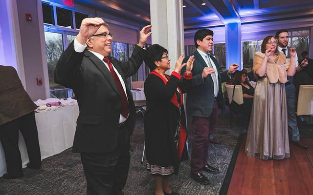 Leonor and Ed Rivera, along with their son, Jordan, doing the Chicken Dance at the wedding of Emily and Stephen Nemeth March 14, 2020.