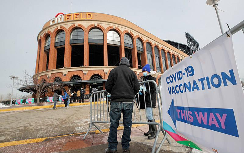 <p>A man in the Queens borough of New York City arrives to receive the COVID-19 vaccine outside Citi Field Feb. 10, 2021, home of the New York Mets. (CNS photo by Brendan McDermid/Reuters)  </p>