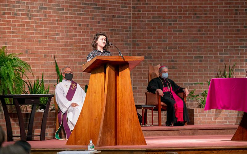 <p> Mackenzie Yaddaw of St. Agnes Church in Avon gives her witness talk during the March 23 Hands of Christ ceremony at St. Lawrence Church in Greece. (Courier photo by Jeff Witherow) </p>