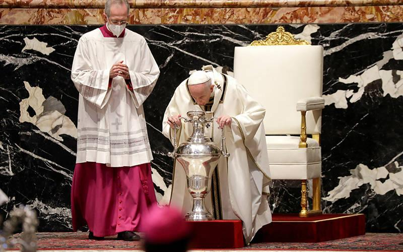 <p>Pope Francis breathes on chrism oil during the Holy Thursday chrism Mass in St. Peter&rsquo;s Basilica at the Vatican April 1, 2021. (CNS photo by Andrew Medichini/Reuters pool)  </p>