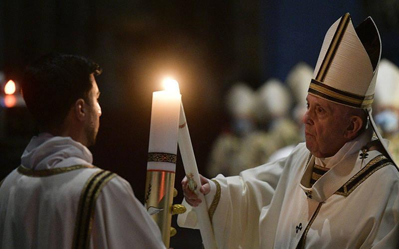 <p>Pope Francis lights the paschal candle at the start of the Easter Vigil in St. Peter&rsquo;s Basilica at the Vatican April 3, 2021. The Easter Vigil was celebrated in a near empty basilica for the second year in a row as Italy continues to fight the COVID-19 pandemic. (CNS photo by Vatican Media)  </p>