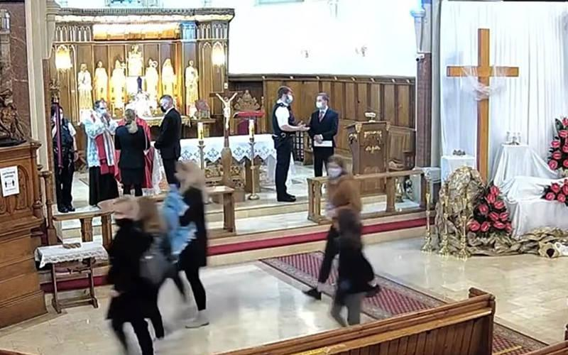<p>Police in London stand on the altar at Christ the King Polish church and halted a Good Friday service after a complaint that pandemic regulations were not being met. The parish claims police &ldquo;brutally exceeded their powers.&rdquo; (CNS screenshot YouTube)  </p>