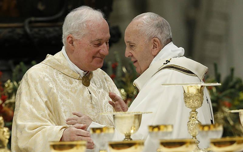<p>Pope Francis greets Cardinal Marc Ouellet, prefect of the Congregation for Bishops, during the sign of peace at a Mass in St. Peter&rsquo;s Basilica at the Vatican in this Jan. 6, 2020, file photo. Cardinal Ouellet announced plans for a major international conference at the Vatican in 2022 on the theology of the priesthood. (CNS photo by Paul Haring)  </p>