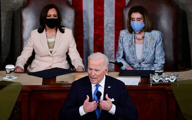 <p>Vice president Kamala Harris and Speaker of the House Nancy Pelosi, D-Calif., listen to President Joe Biden addresses to a joint session of Congress in the House chamber of the U.S. Capitol in Washington April 28, 2021.  </p>