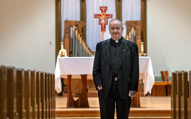 <p> Father Richard Brickler is seen at Nazareth College's Linehan Chapel, where he regularly celebrates Mass.