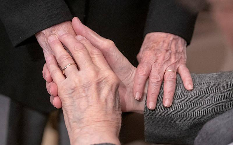 <p> A couple holds hands during the May 20, 2019, Wedding Recognition Mass at Rochester's Sacred Heart Cathedral. </p>