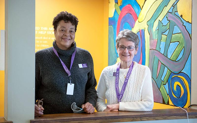 <p>Sister Sheila Briody (right) is seen with Robyn Carter at St. Joseph's Neighborhood Center in Rochester.