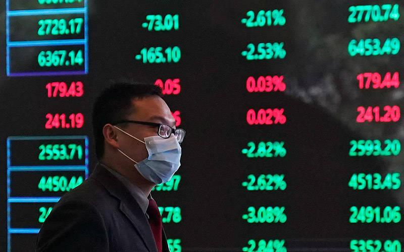 <p>A man wearing a protective mask is seen inside the Shanghai Stock Exchange building during the coronavirus outbreak, at the Pudong financial district in Shanghai in this Feb. 28, 2020, file photo. In a May 4 video message, Pope Francis said markets must be regulated and the poor protected. (CNS photo by Aly Song/Reuters)  </p>