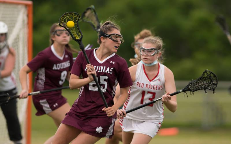 <p>Aquinas Institute&rsquo;s Sienna Hinchcliffe (left) works around Palmyra-Macedon&rsquo;s Clare Boesel during the Section 5 Class D girls&rsquo; lacrosse championship at Pal-Mac June 11. (Photo by Greg Francis)  </p>