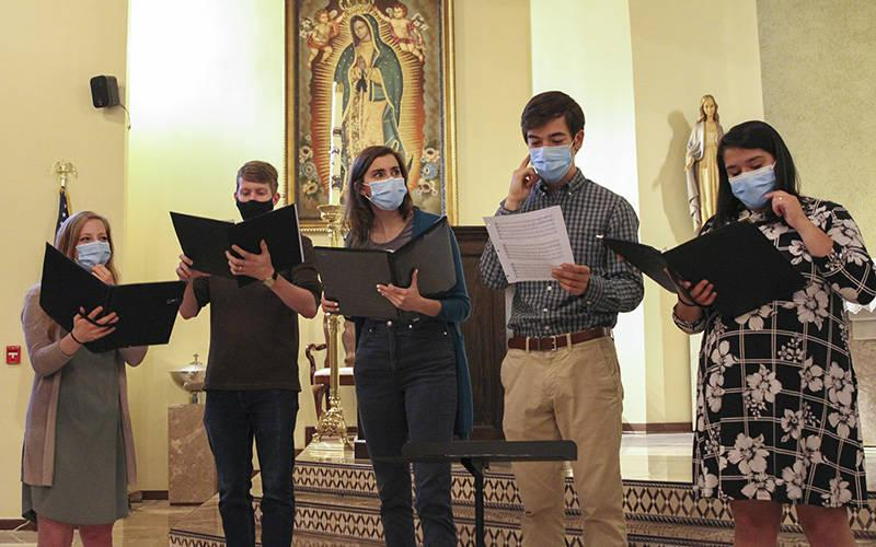 <p>Carrie Sturniolo, left, Connor Lawson, Genevieve Leopold, Ben Dollar and Valeska Lawson are five of the eight original members of the Concordi Laetitia chorale. They are shown rehearsing inside the Catholic Center chapel on the Georgia Tech campus in Atlanta in this undated photo. (CNS photo by Michael Alexander/The Georgia Bulletin)  </p>