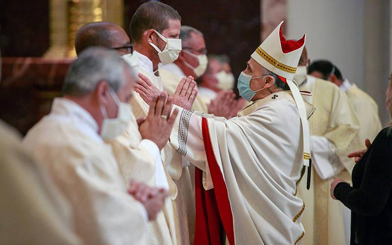 <p>Cardinal Daniel N. DiNardo of Galveston-Houston greets newly ordained Deacon Bruce Flagg during an ordination Mass for permanent deacons at the Co-Cathedral of the Sacred Heart in Houston Feb. 20, 2021. Deacon Flagg, who is deaf, assists with deaf ministry in the Archdiocese of Galveston-Houston. (CNS photo by James Ramos/Texas Catholic Herald)  </p>