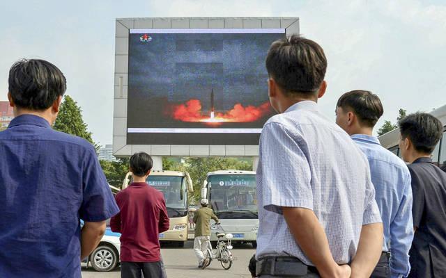 <p>North Koreans watch a news report of an intermediate-range ballistic missile launch on a big screen at Pyongyang station in Pyongyang, North Korea, Aug. 30. </p>