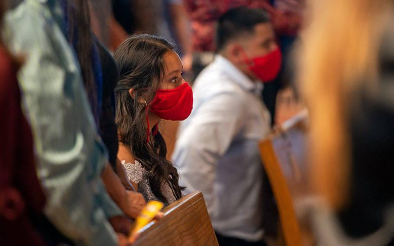 <p>Yeisly Callejas Chavez kneels during the confirmation liturgy at St. Mary of the Lake Church in Ontario June 26. (Courier photo by Jeff Witherow)   </p>