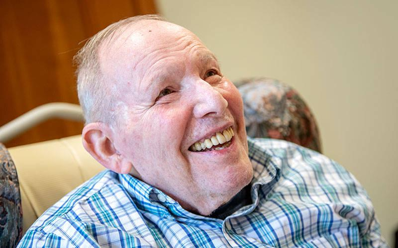 <p>Bishop Emeritus Matthew H. Clark smiles July 14 at the Sisters of St. Joseph Motherhouse in Pittsford during a celebration to recognize his 84th birthday on July 15. (Courier photo by Jeff Witherow)  </p>