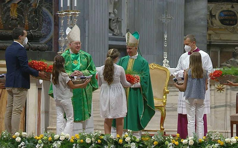 <p>Cardinal Kevin J. Farrell, prefect of the Dicastery for Laity, Family and Life, and Archbishop Rino Fisichella, president of the Pontifical Council for the Promotion of the New Evangelization, bless baskets of flowers that young people distributed to older people in a Mass in St. Peter&rsquo;s Basilica in the Vatican July 25, 2021. The Mass inaugurated the first World Day of Grandparents and the Elderly. (CNS photo by Vatican Media)  </p>