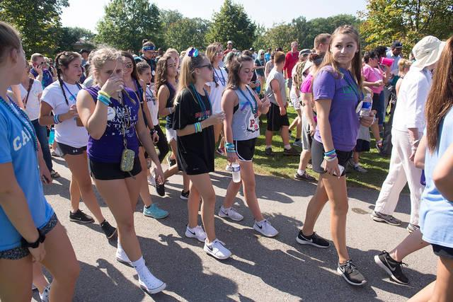 <p>More than 2,200 people take park in the annual Out of the Darkness Community Walk on Sept. 24 at Genesee Valley Park in Rochester.