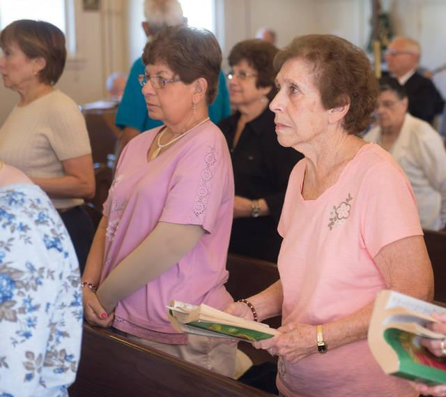 <p>Rose Giovine, a lifelong parishioner of Rochester's Annunciation Church, attends Mass at the church Sept. 23.  </p>