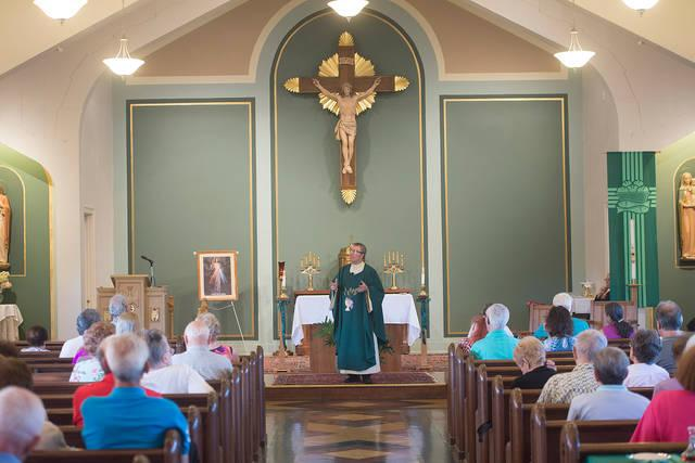 """<p>Father William """"Mickey"""" McGrath speaks to congregants during Mass at Annunciation Church in Rochester Sept. 23.  </p>"""