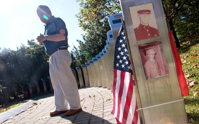 <p>Vietnam veteran Chuck Macaluso tours the Walk of Honor at the Vietnam Memorial in Rochester's Highland Park Oct. 20.  </p>