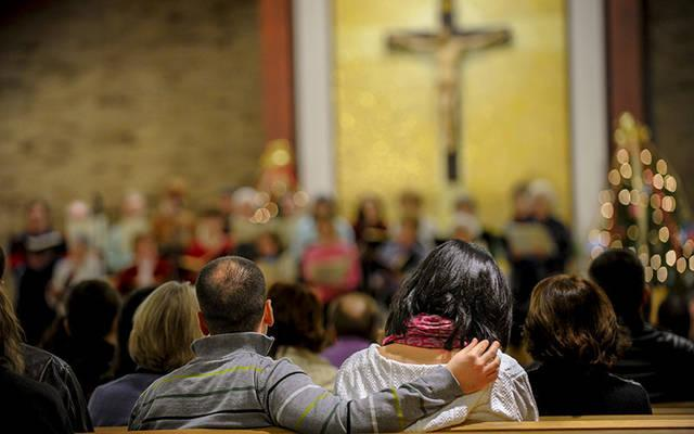 <p>Congregants listen to music at St. Joseph Church in Penfield in 2010 during a night of music to celebrate Twelfth Night, which is the conclusion of the Christmas season. (File photo) </p>