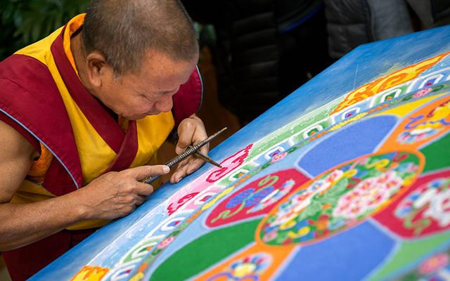 <p>The Venerable Tenzin Yignyen, a Tibetan Buddhist monk, creates a sand mandala Nov. 5 in the lobby of St. Ann&rsquo;s Community in Rochester as part of a weeklong series of events honoring grief.  (Courier photo by Jeff Witherow)   </p>