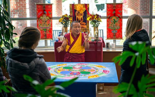 <p>The Venerable Tenzin Yignyen, a Tibetan Buddhist monk, speaks to residents and visitors about compassion and grief Nov. 5 at St. Ann&rsquo;s Community in Rochester. (Courier photo by Jeff Witherow)  </p>